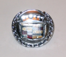1976-9 Cadillac trunk lock badge with wreath