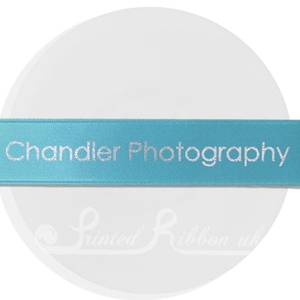 PW25TURQ25M 25m roll of personalised, printed 25mm wide TURQUOISE / AQUA double faced (d/f) satin ribbon