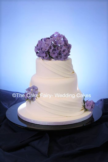 RS18   DRAPES & HYDRANGEAS  3 tier stack decorated with sugar drapes and sugar hydrangeas