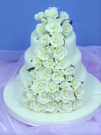 RS17A   TUMBLING ROSES & PETALS    3 tier stack wedding cake decorated with handcrafted sugar roses and fallen sugar petals.
