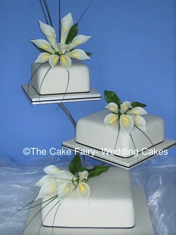 S10   ARUM ELEGANCE   Very classic display of handcrafted sugar arums on ivory wedding cakes