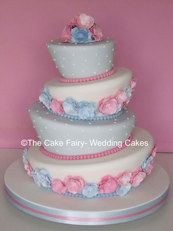 RW17 WONKY PASTELS    Wonky wedding cake with a  side design of sugar blossoms and dots to compliment colour scheme