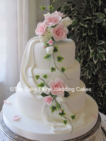 RS48   ROSE & TULIP DRAPE    A romantic elegant wedding cake with sugar drapes and handcrafted sugar roses, tulips and variegated ivy.
