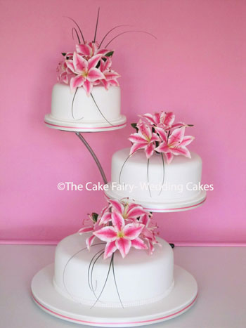R49   STARGAZER  A classic floral wedding cake with handcrafted sugar stargazer lilies.