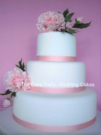 RS53   PEONY  A modern floral wedding cake wtih handcrafted sugar peonies and a small dot side design.