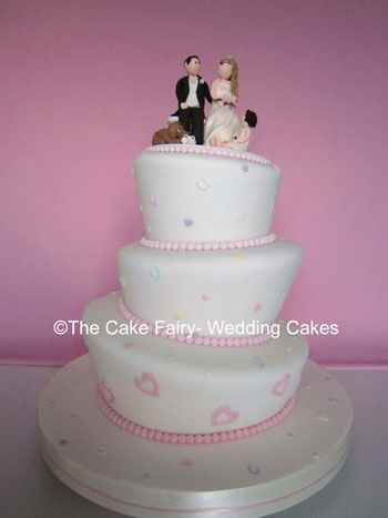 RW19  WONKY CONFETTI   Pretty pastel wonky cake with topper of sugar Bride & Groom and decoration of sugar confetti
