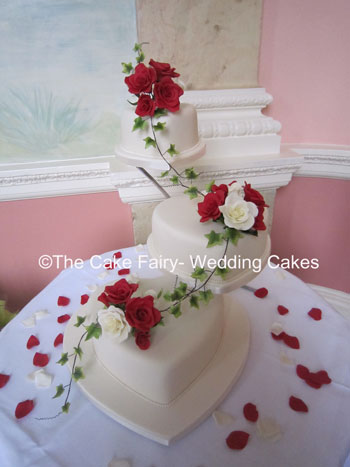 H8 ROMANCE    A very romantic wedding cake entined with sugar ivy and finished with handcrafted sugar roses