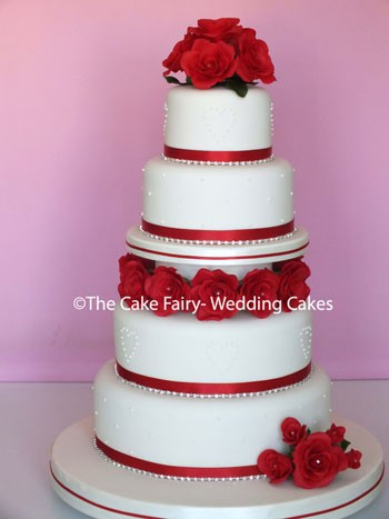 R65 CHERRY RED GARLAND  Handcrafted red sugar roses separating tiers of wedding cake