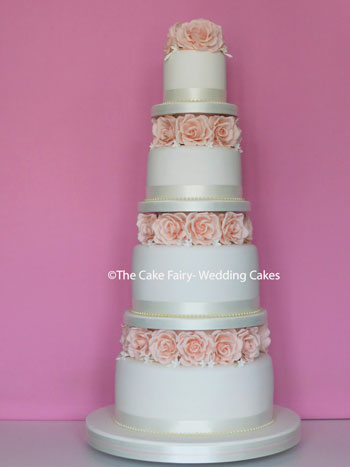 R78 BLUSH ROSE GARLAND    Deep tiers of Wedding Cake separated by handcrafted sugar roses and jasmine