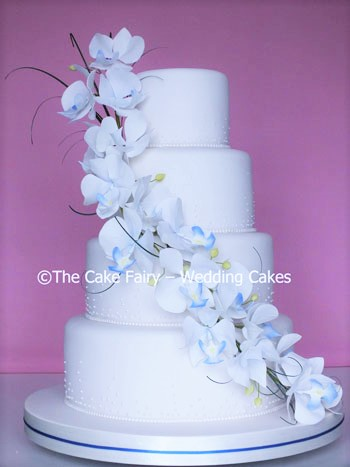 RS147 ORCHID SWIRL  A large swag of handcrafted sugar orchids finishing a champagne bubble Wedding Cake