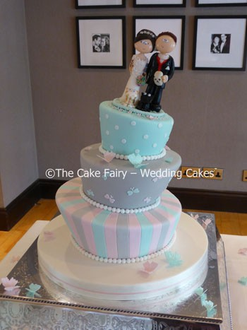 RW62 WONKY TONES  Lots of pastel colours give this wedding cake great impact. Finished with a topper supplied by the client