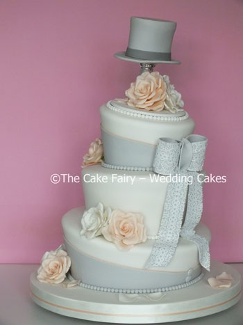 RW63 WONKY TOPPER   Perfect for an unusual vintage style wedding day. Topped with a sugar top hat and roses