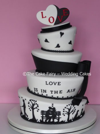 RW65 WONKY LOVE    One of my silhouette inspired Wedding Cakes topped with a pair of sugar hearts