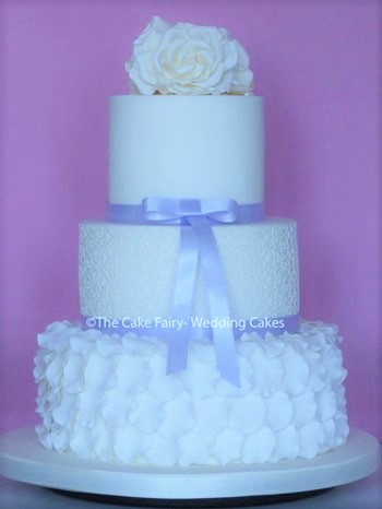 RS150 SWANLAKE   A pretty Wedding Cake finished with edible lace and sugar petal ruffles