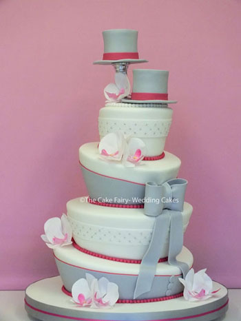 RW74 WONKY TOPPERS + TAILS    Sugar toppers perched on top of a fun loving design and descoration to coordinate with the couples colour scheme
