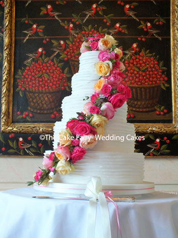 RS158 FRILLS + FRESH FLOWERS  A sugar frilled Wedding cake dressed with fresh flowers from the bridal collection