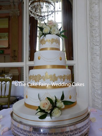 RS178 GOLD LACE   A very elegant Wedding cake dressed with edible gold lace