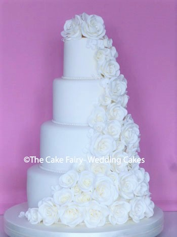 RS191 ROSE VEIL   Handcrafted sugar roses wrapped around a 4 tier Wedding Cake
