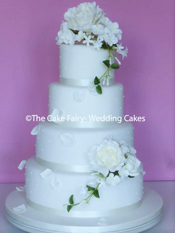 RS186 PEONY POLKA   Handcrafted sugar  peonies, roses and hydrangea blossoms decorating a polka dot decorated Wedding Cake