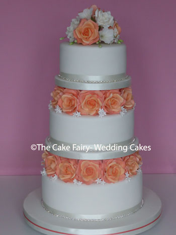 RS85 MANGO ROSE- Cake tiers separated with hancrafted sugar roses for extra height