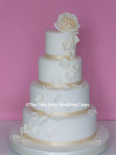 RS246 PETAL BREEZE  An elegant wedding cake finished with cream sugar roses and petals