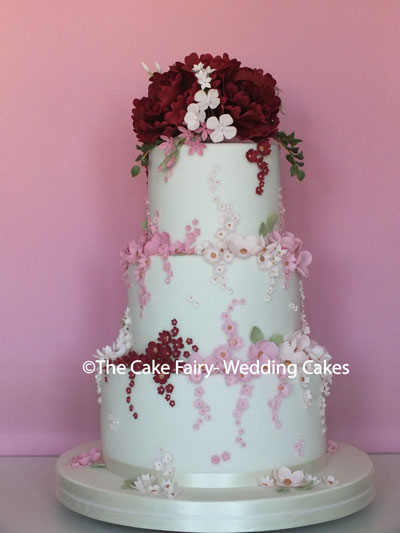 RS254 BLOSSOM DELIGHT   Decorated with pretty sugar blossoms and topped with sugar peonies