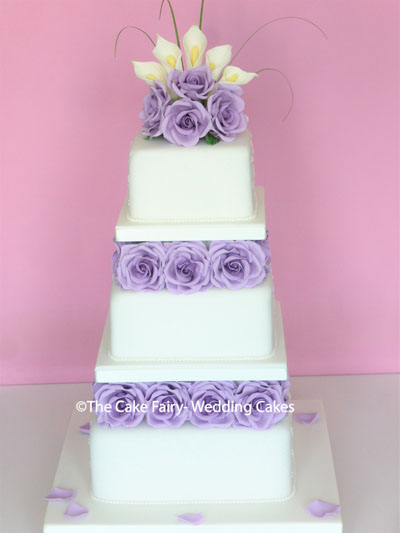 S18 LILAC LAYERS  Square tiers divided by lilac sugar roses