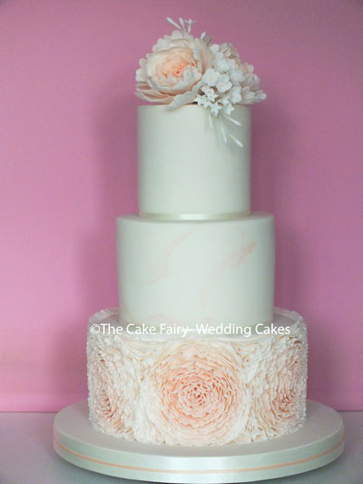 RS285 APRICOT PEONIES  Peony style sugar ruffles, subtle apricot marbling and sugar peonies and blossoms