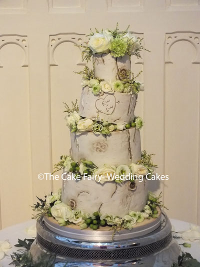 RW86 TIPSY BIRCH  Birch bark decorated cake tiers finished with lots of fresh flowers