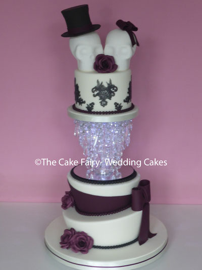 RW88 GOTHIC ROMANCE  Handcrafted sugar skulls and roses on a quirky wonky cake set up