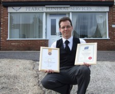 John Pearce holding his membership certificates