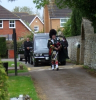 A Scottish Piper leading our funeral cortege
