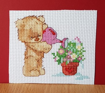Teddy Card: Teddy 'watering his flowers' in Cross Stitch