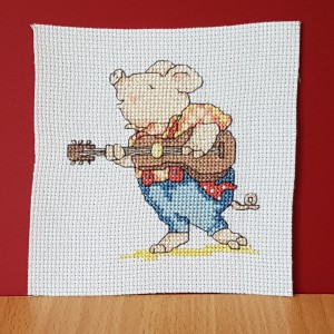 Pig Card: Pig 'playing his guitar' in Cross Stitch