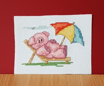 Pig Card: Pig 'relaxing in the sun' in Cross Stitch