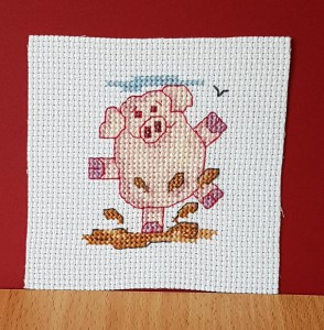 Pig Card: Pig 'playing in the mud' in Cross Stitch