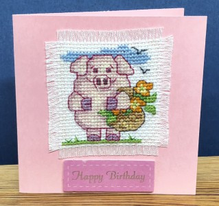 Pig Card: Pig 'with a basket of flowers' in Cross Stitch
